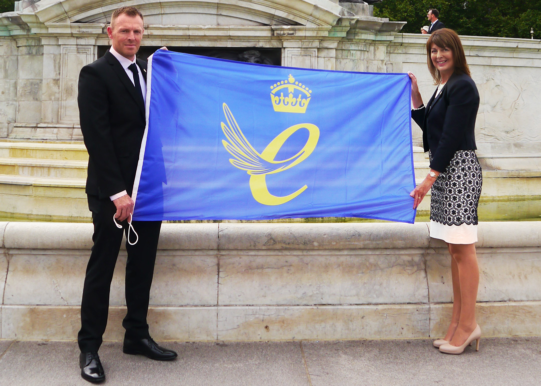 queen's award flag hold